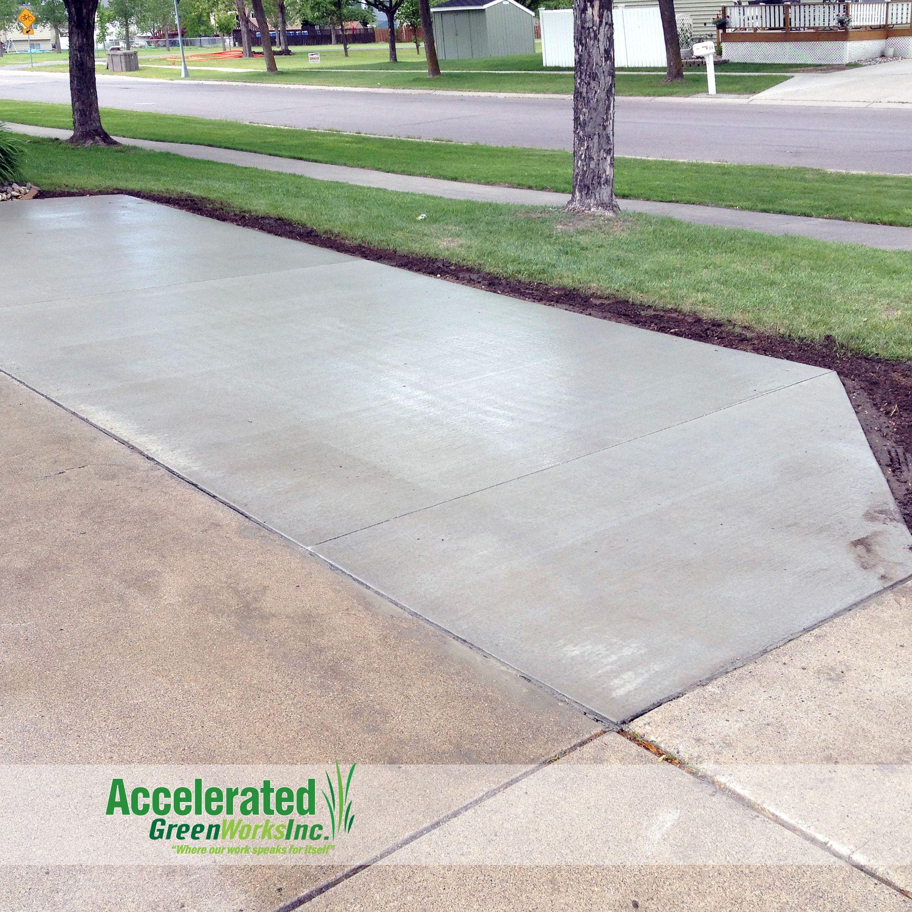 a standard grey concrete driveway extension