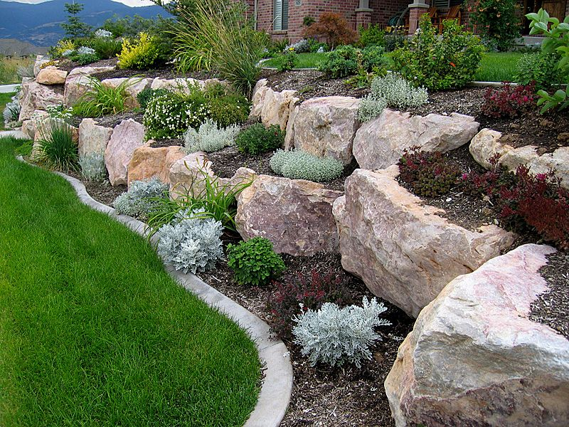 boulder retaining walls that are included in the garden make the garden feel natural and also unique architectural landscape design edging