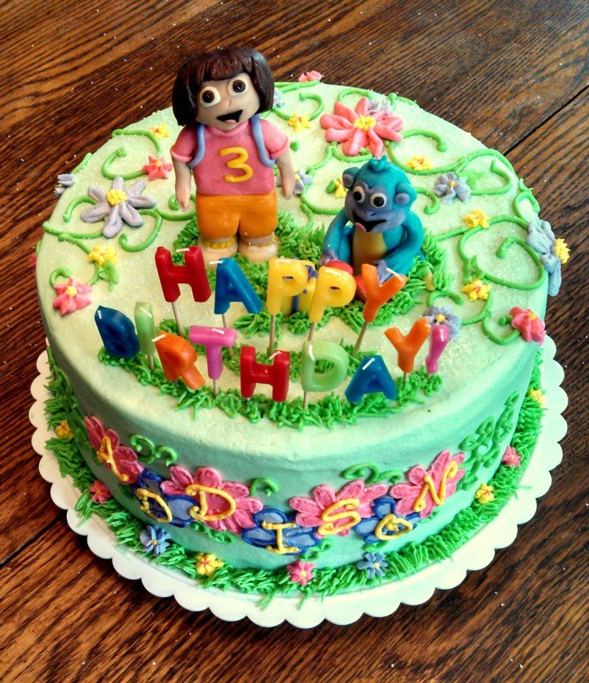 Dora the Explorer birthday cake! All buttercream with candy clay Dora and Boots! The Happy Birthday letters are candles! 10in round 2 layer cake! https://www.facebook.com/angelas.cakes2011