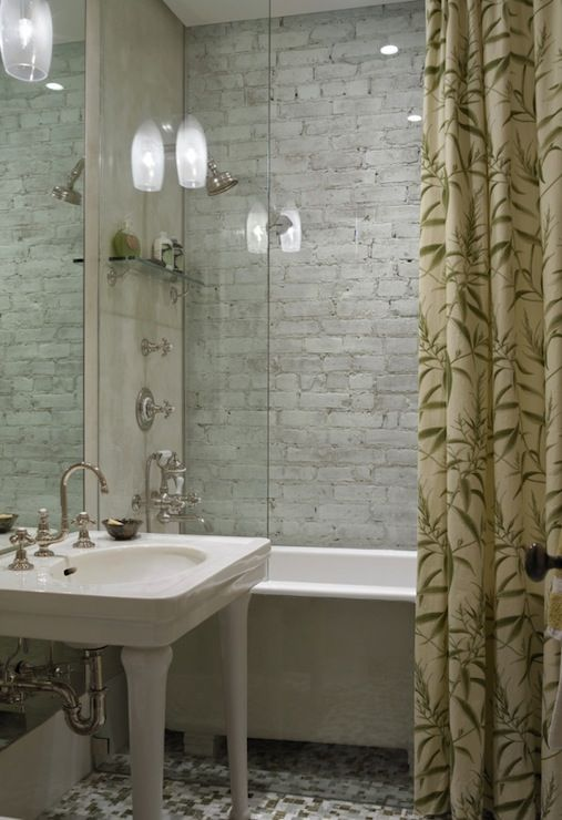 Love the brick in the shower, the tub, the partial glass wall ...