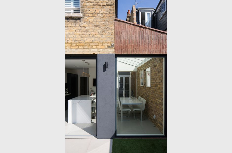Yard Architects Stacked Clay Creasing Tiles With Dark Aluminium Framed Glazing And Colour Matched Render To