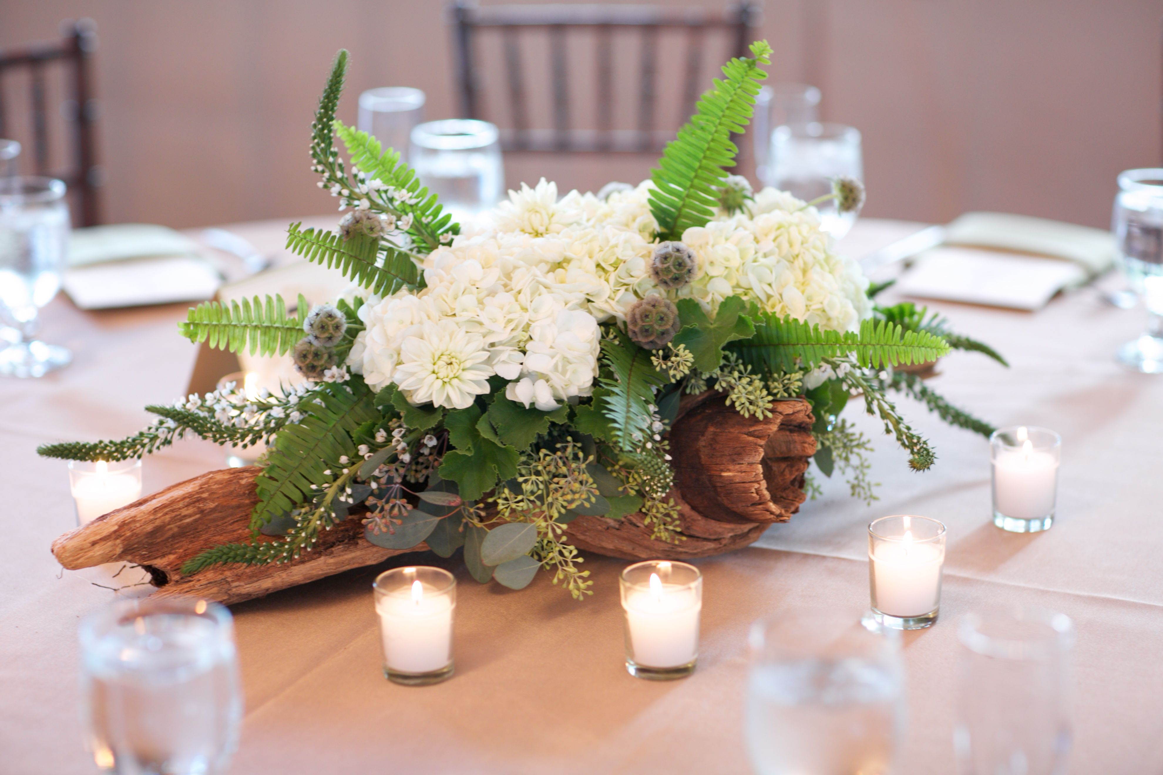 White hydrangea with seed eucalyptus were not created for Driftwood table centerpieces