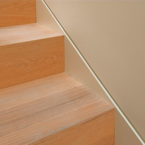 how to cut baseboard at top of stairs