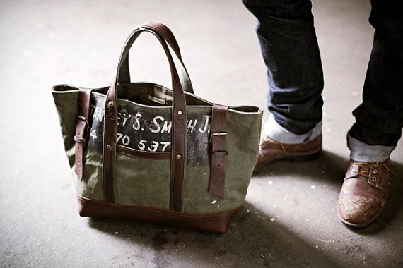 cd1cd1d698df Men s  bag. Worn-in canvas salvaged from a WWII era US military duffel ...