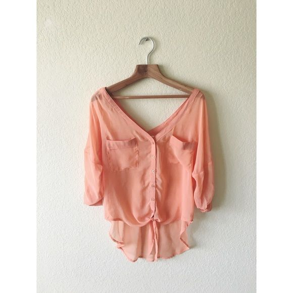 Chiffon coral pink tie waist top size small. Worn twice and in great condition except for the pull in the front as shown in picture 2. Sheer. Buttons and ties and the waist. Can be worn off shoulder as the neckline is wide. No trades. Double Zero Tops Blouses