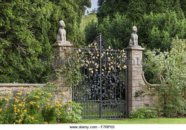 The iron gates seen from the Formal Garden at Mount Stewart, County Down. Mount Stewart has been voted one of the world's top ten gardens, and reflects the design and artistry of its creator, Edith, Lady Londonderry. - Stock Image