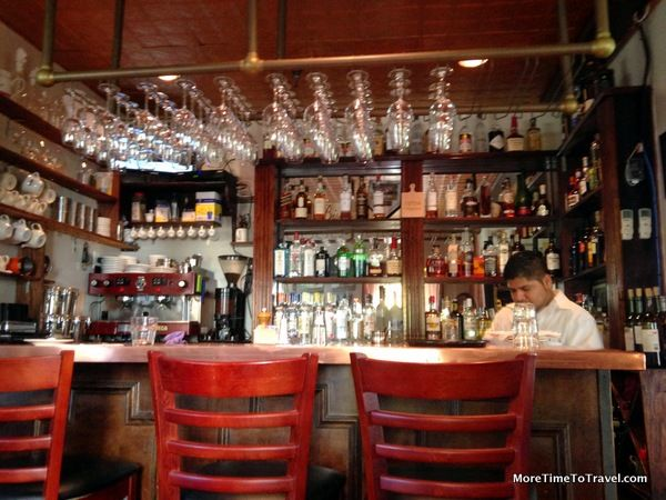 A comfortable place to belly up to the bar at Le Jardin du Roi