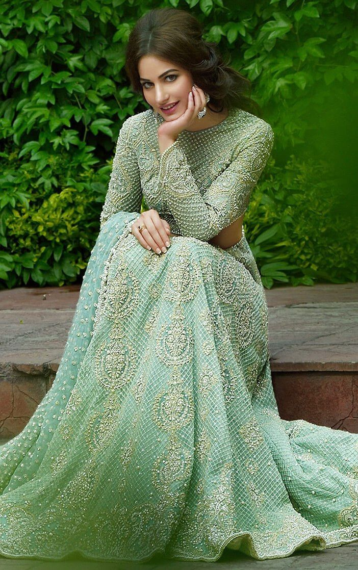 ebe106ca7a This designer lehenga is featured in mint green color gorgette with hand  embroidered zardozi work. Embroidery is in dabka, diamontale and silk  threads.