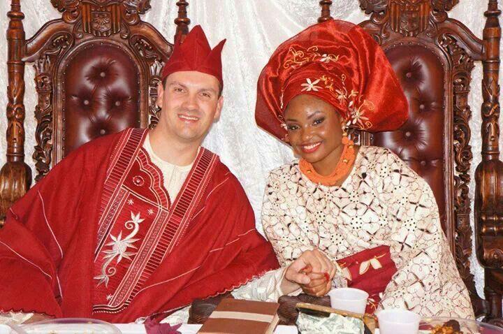 Interracial Nigerian bride white groom Red wedding colors gele