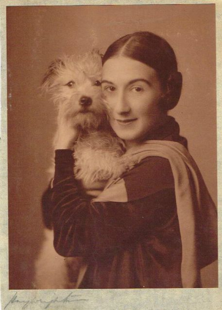 Betty Chester (1895–1943) and her pet terrier, 1920s. English actress, mostly in the 1920's.