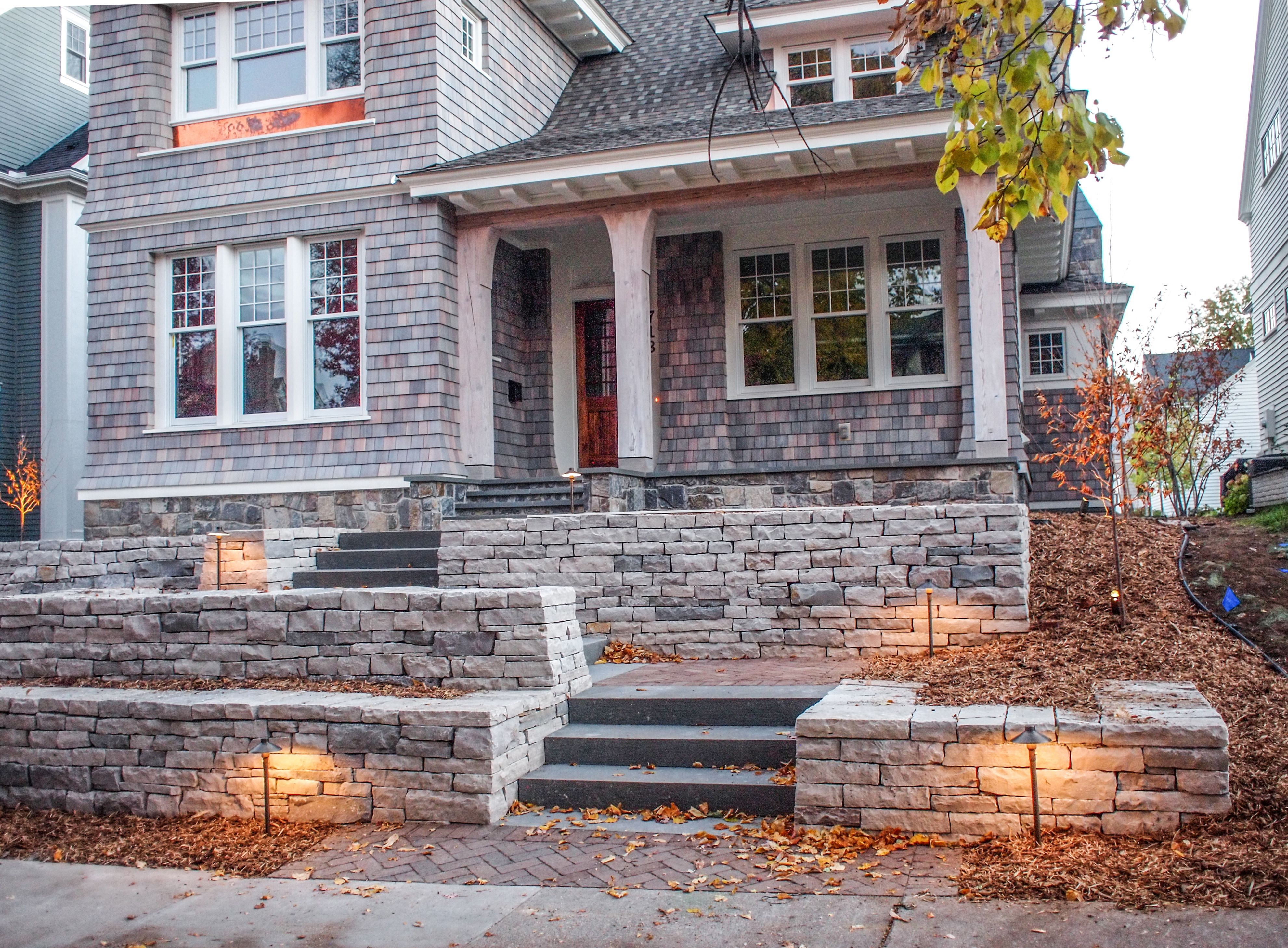 A Season Designer Shows A Gallery Of Amazing Work Including This Stone With Brick Paver Landings Entrance Landscape Design Brick Outdoor Makeover