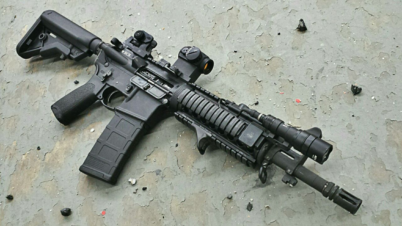"AR 15 with 14.5"" barrel, probably pinned."