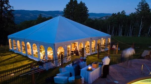 Party Tent Glowing Warm at Dusk with Cool Blue Light  from  Excellence Photobooth.