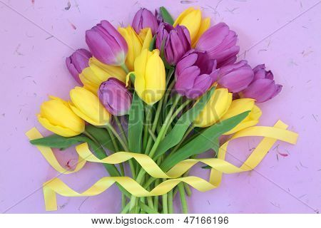 Yellow And Purple Tulip Flower Bouquet With Ribbon Over Mottled Lilac Background Fresh Tulips Tulips Flowers Tulips