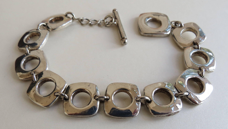 Hip mid century sterling silver open shape modernist link bracelet