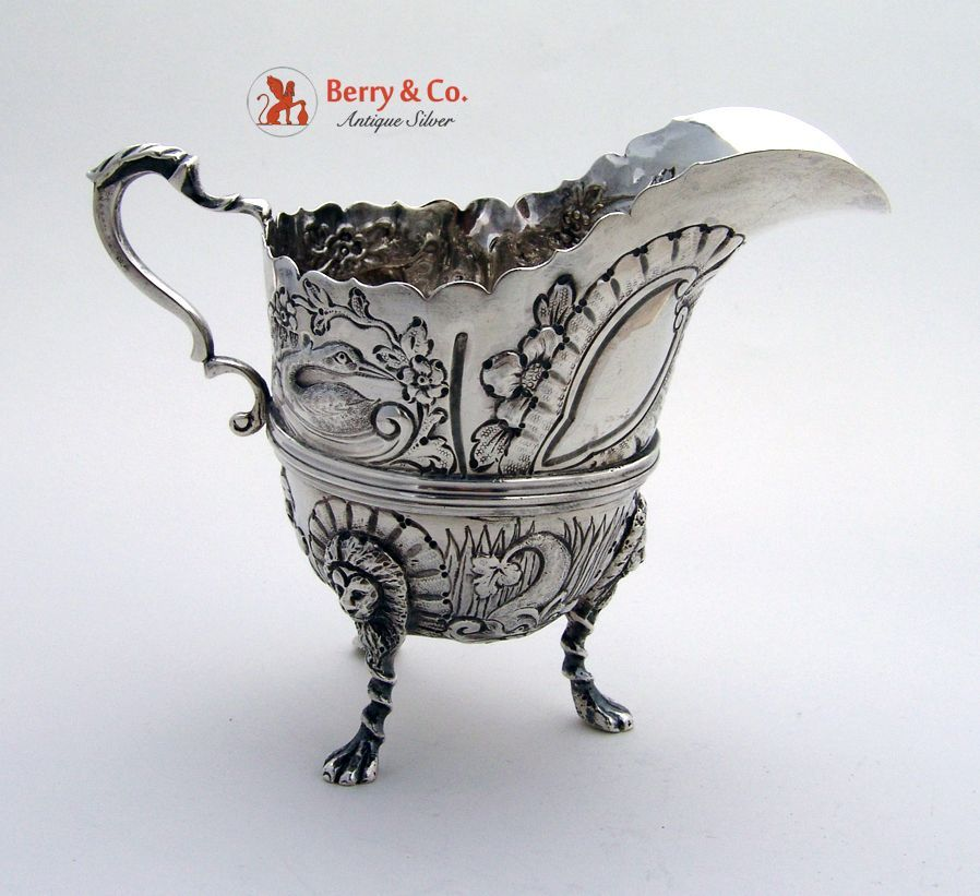 English sterling silver floral Repousse body with a fox, a dog, a goose, a dolphin and a swan, sitting on three lion mask paw feet and a triple