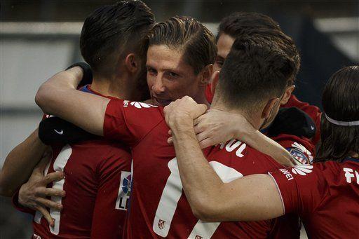 Torres vuelve a marcar y el Atlético alcanza al Barcelona - http://a.tunx.co/Eo7x4