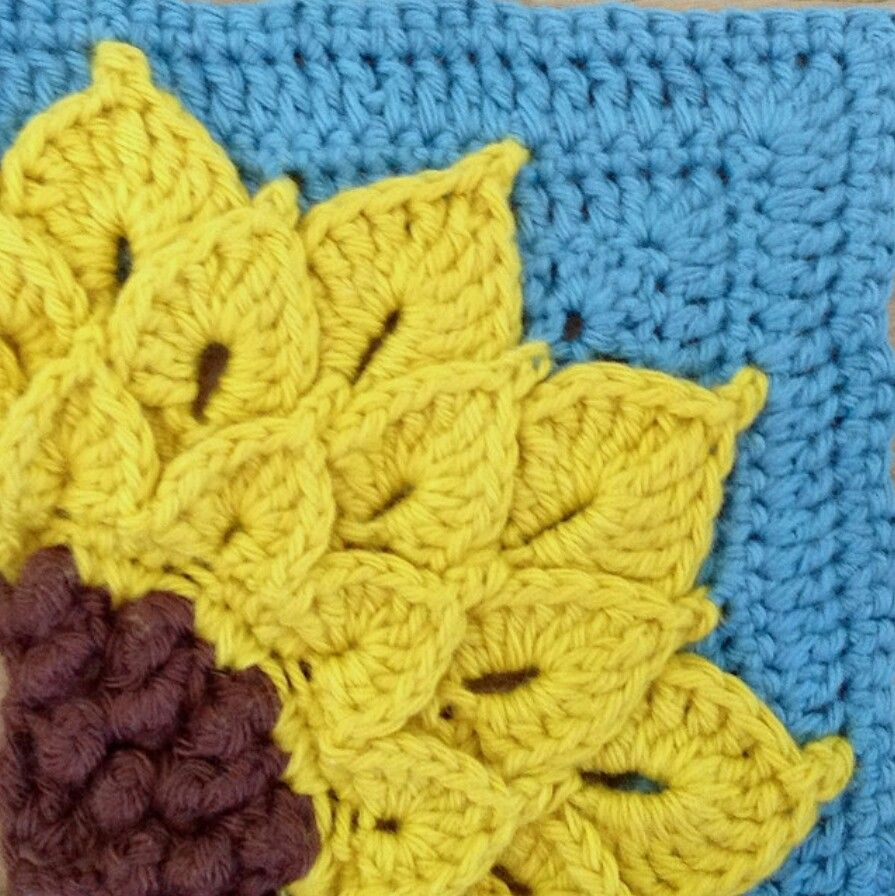 Sunflower Square (could use Crocodile Stitch Dahlia pattern as well....but I like the corner presentation and center)  http://www.ravelry.com/patterns/library/quarter-sunflower-square