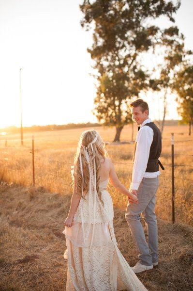 see bride from behind, groom looking at bride