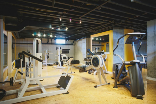 Basement home gym in semifinished basement. Ceiling is
