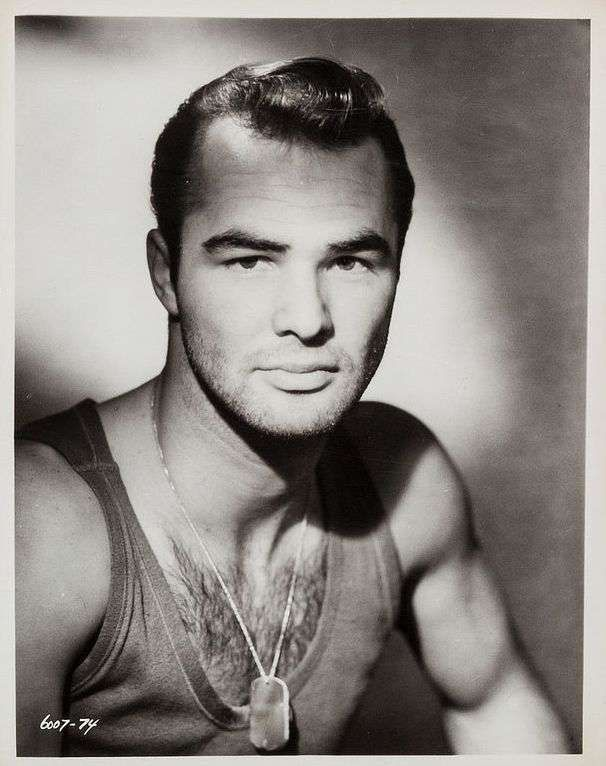 Young Burt Reynolds In A Tank Top