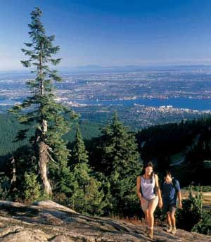 There are hiking trails to suit every ability in North and West Vancouver, BC. This couple is hiking on Grouse Mountain in North Vancouver.
