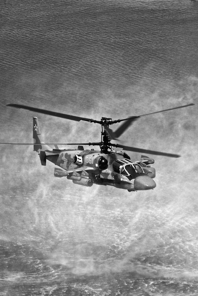 Helicopters fire sky