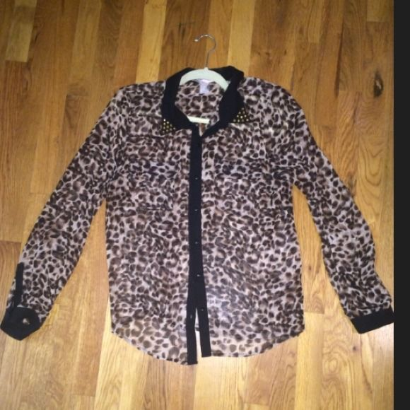Animal Print Studded Button Down Shirt Animal Print Button Down Shirt. Studded Collar on both sides. 2 front pockets. Solid black on the color, down the front and on end of the sleeve. Forever 21 Tops Button Down Shirts