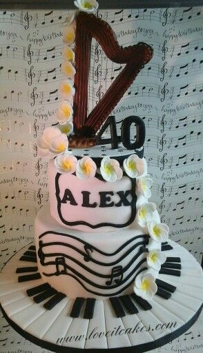 2 tier music cake with harp topper, frangipani flowers and piano ...
