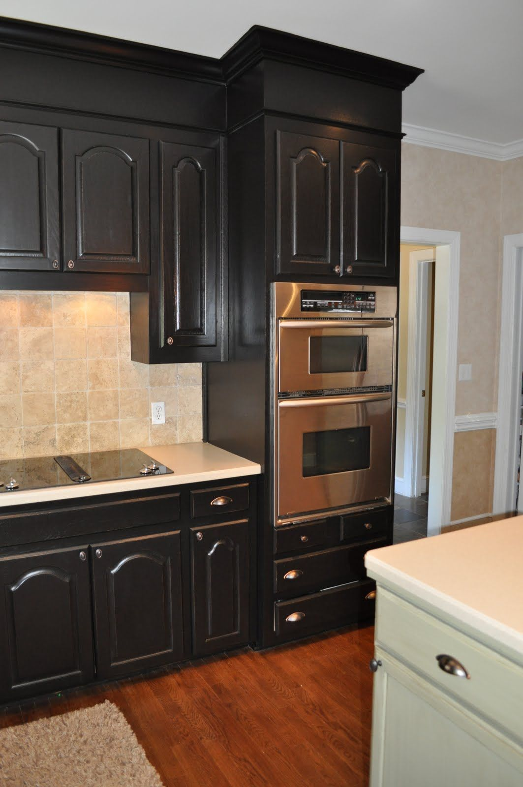 Great transition from black cupboards to wood floors to white trim