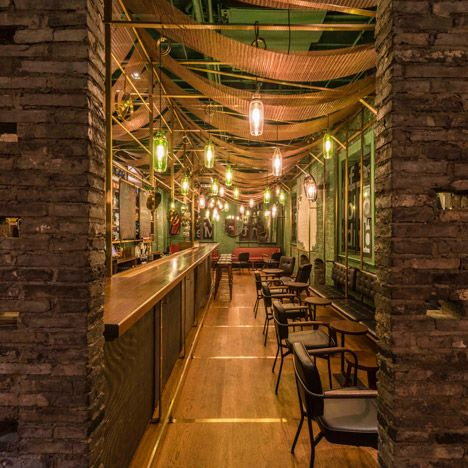 chinese studio nerihu has added bamboo lined booths and green glass lampshades to a shanghai bar that specialises in one drink punch