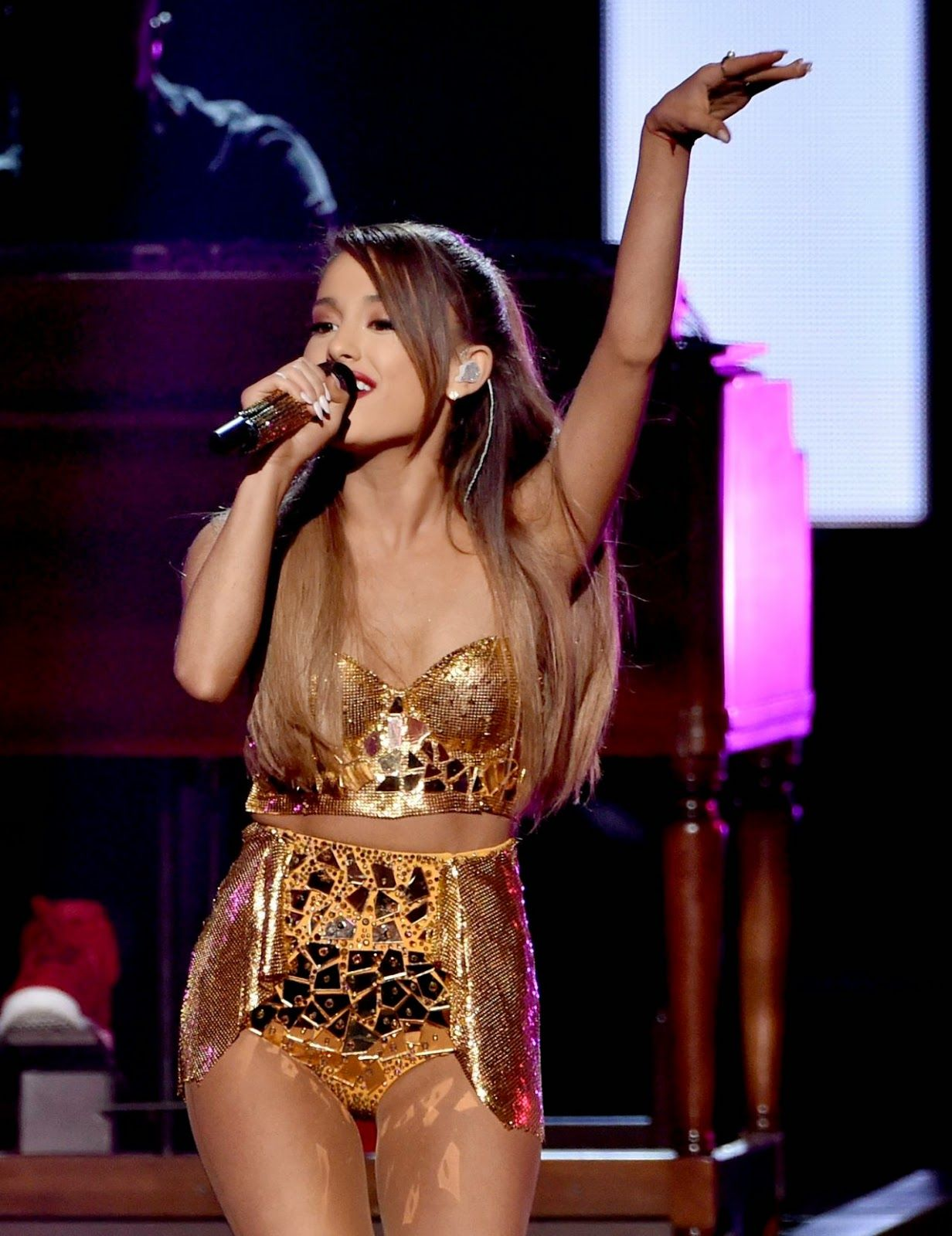 Ariana Grande Performs In A Leather Mini Skirt