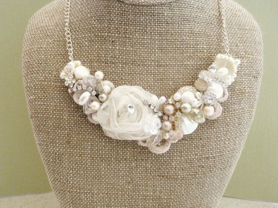 Blush Bridal Bib Necklace- Champagne Pink Wedding Statement Necklace- Rosette, Pearls, Lace, & Rhinestones. $75.00, via Etsy.