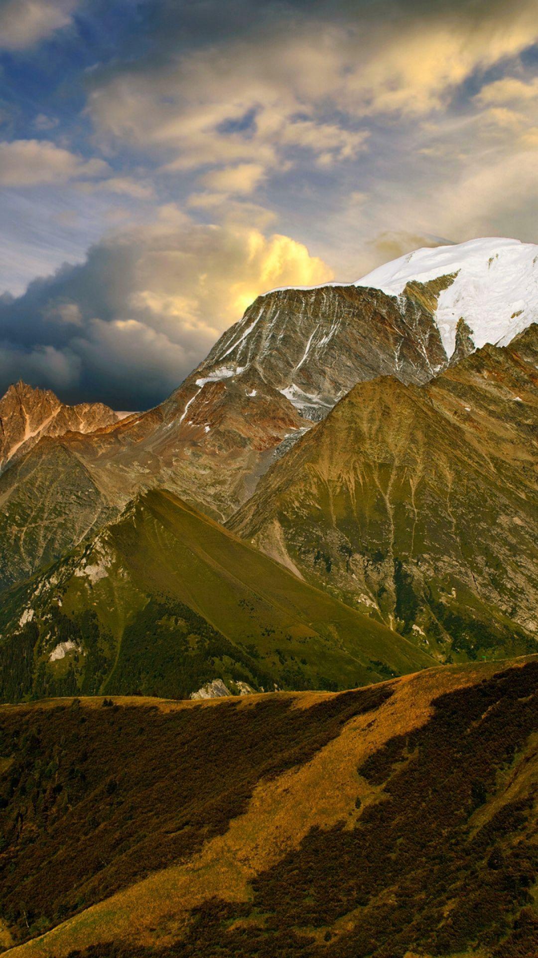 Download Wallpaper 1080x1920 mountains clouds sky orange decline
