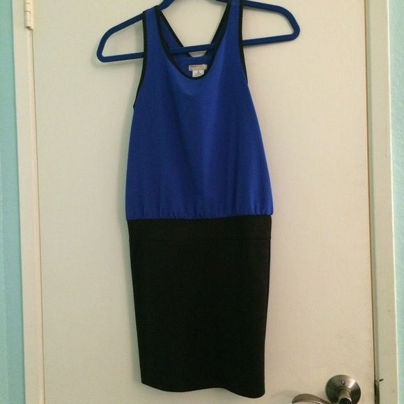 Sally Miller Color Block Dress Sally Miller color block dress. Blue top and black pencil like skirt sown together as a dress. barely worn, worn maybe once or twice. the sizing is in youth because the dress is made for tweens, but it still fits me and I am 5' tall so if you are a petite person it should fit you. Sally Miller Dresses #sallymiller