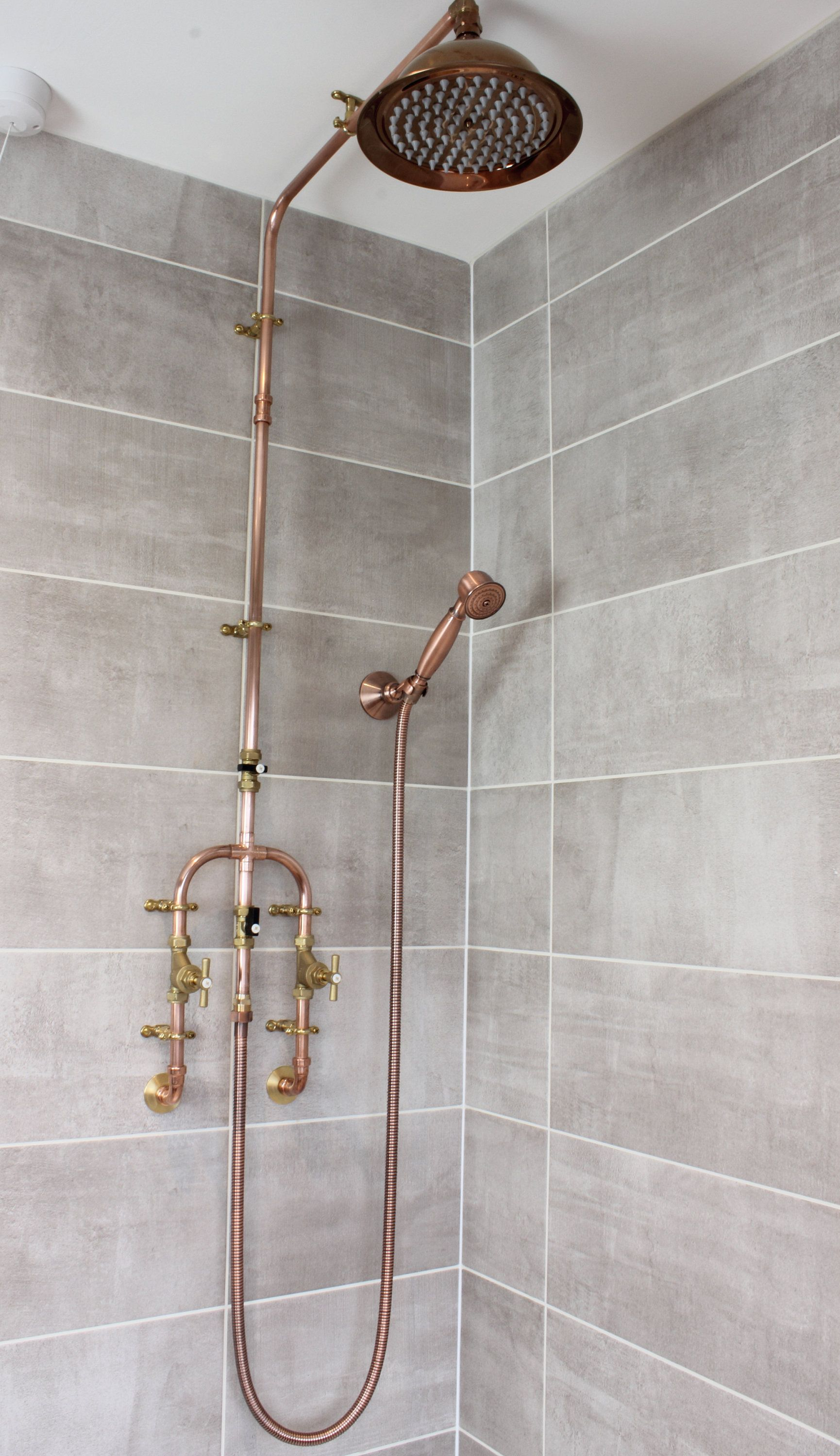 Photo of Copper shower with fixed head and flexible handset