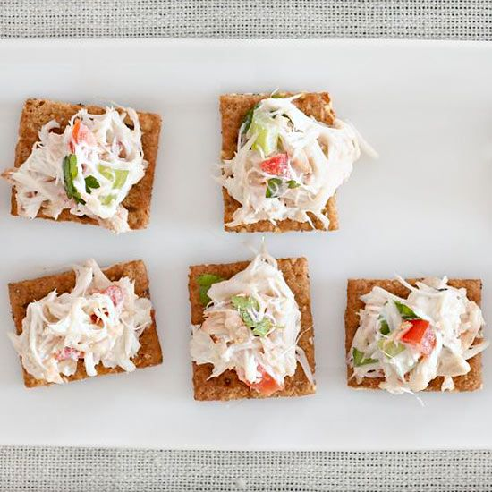 Amp up purchased crab salad with toasted almonds and fresh parsley. Place on pumpernickel bread for an easy, four-ingredient party pleaser. /