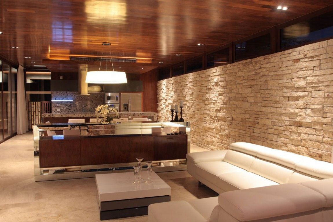 Dise o de casa en forma de l con moderna fachada y - Decoracion moderna de interiores ...