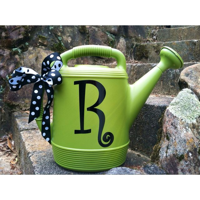 I bought this watering can from Walmart and added the vinyl initial and now for a cute teacher's gift.  I will probably put a bouquet of daisies in it before I give it to my son's teacher.