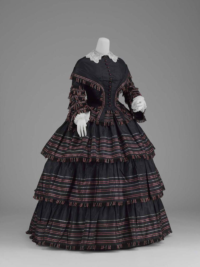 In Pretty Finery Day dress  1855, America  Silk plain weave (taffeta) with weft-float patterning (à la disposition) MFA Boston
