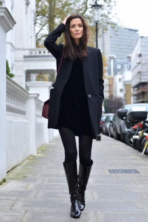 We're in love with knee-high boots for fall. Want ideas for how to wear your pair? Click to see how street style stars are wearing theirs, including this all-black look with tights, a dress, and long blazer.