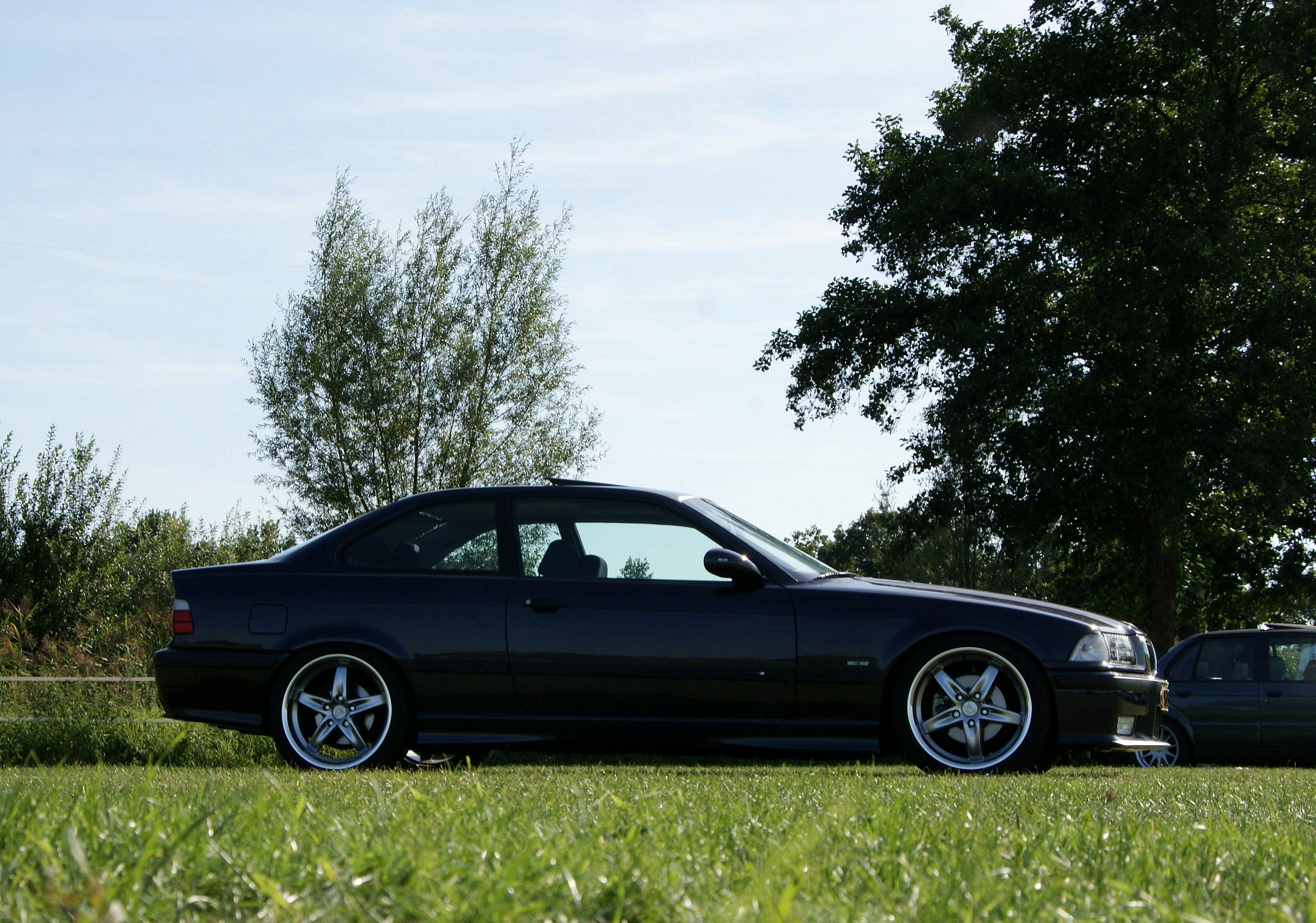 E36 bmw 328i coupe sport in madeira violet with 18inch hamann alloys
