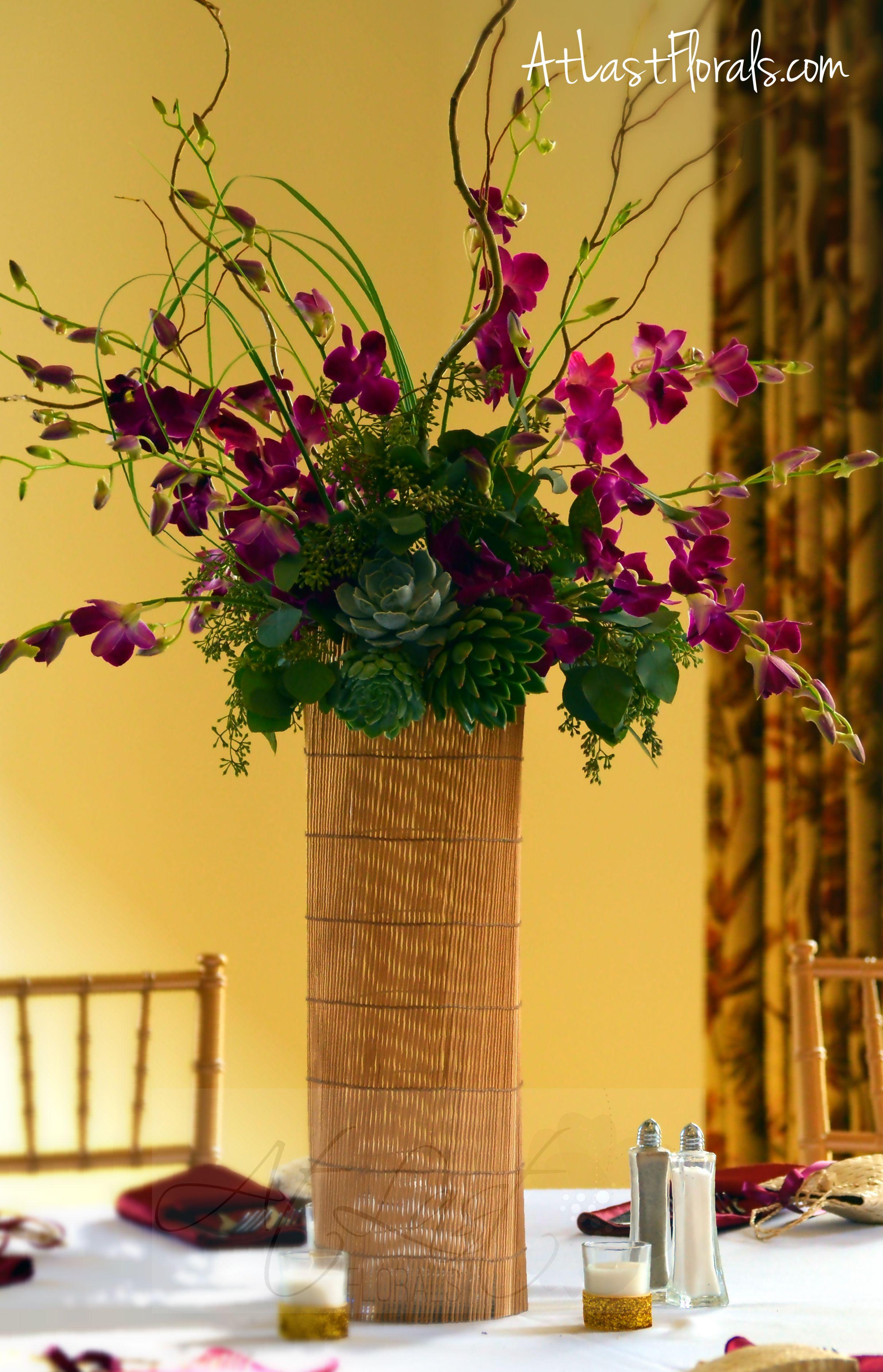 Unique centerpiece modern flowers purple orchids and