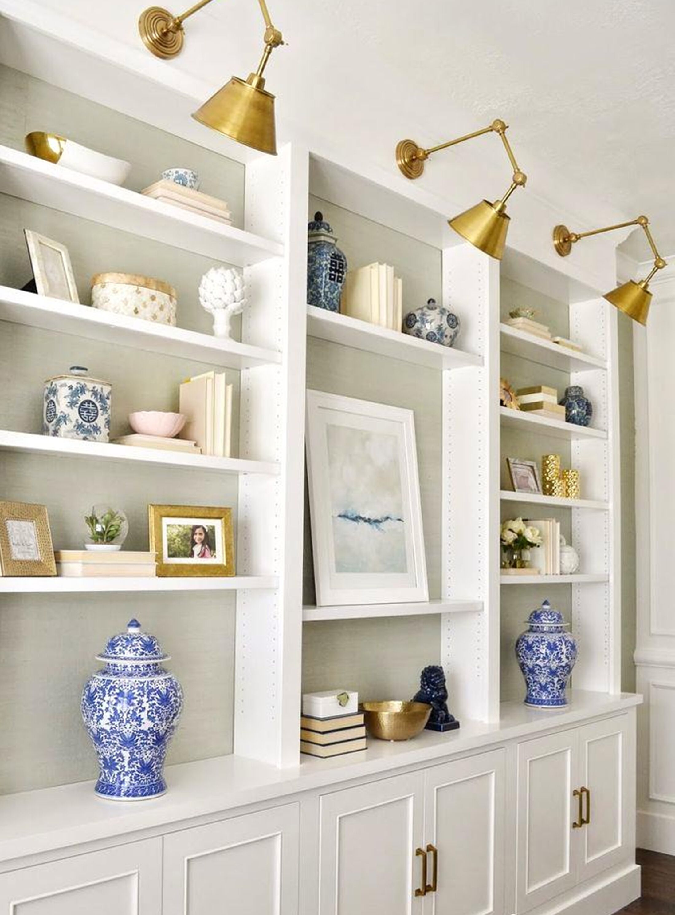 Brass sconce lights over built in shelves. | Shelf Styling Ideas ...