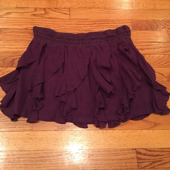 Free People ruffled skirt Plum colored ruffled skirt with a crocheted elastic banded waist. Shell is 65% viscose/35%cotton. Liner is 100%cotton. Very cute! Free People Skirts Mini
