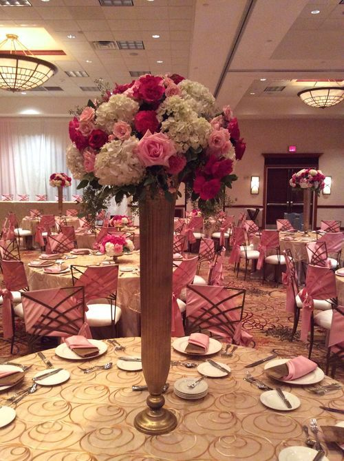 Ivory fuschia and light pink roses in white hydrangeas