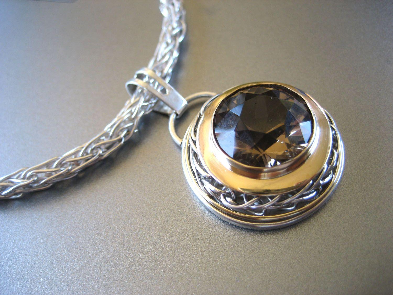 Handwoven chain and embellishment around the bezel set quartz anna