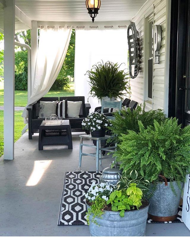 45 Best Cottage Style Garden Ideas And Designs For 2020: Sunny Summer Porch With Outdoor Curtains, Big Wreaths In