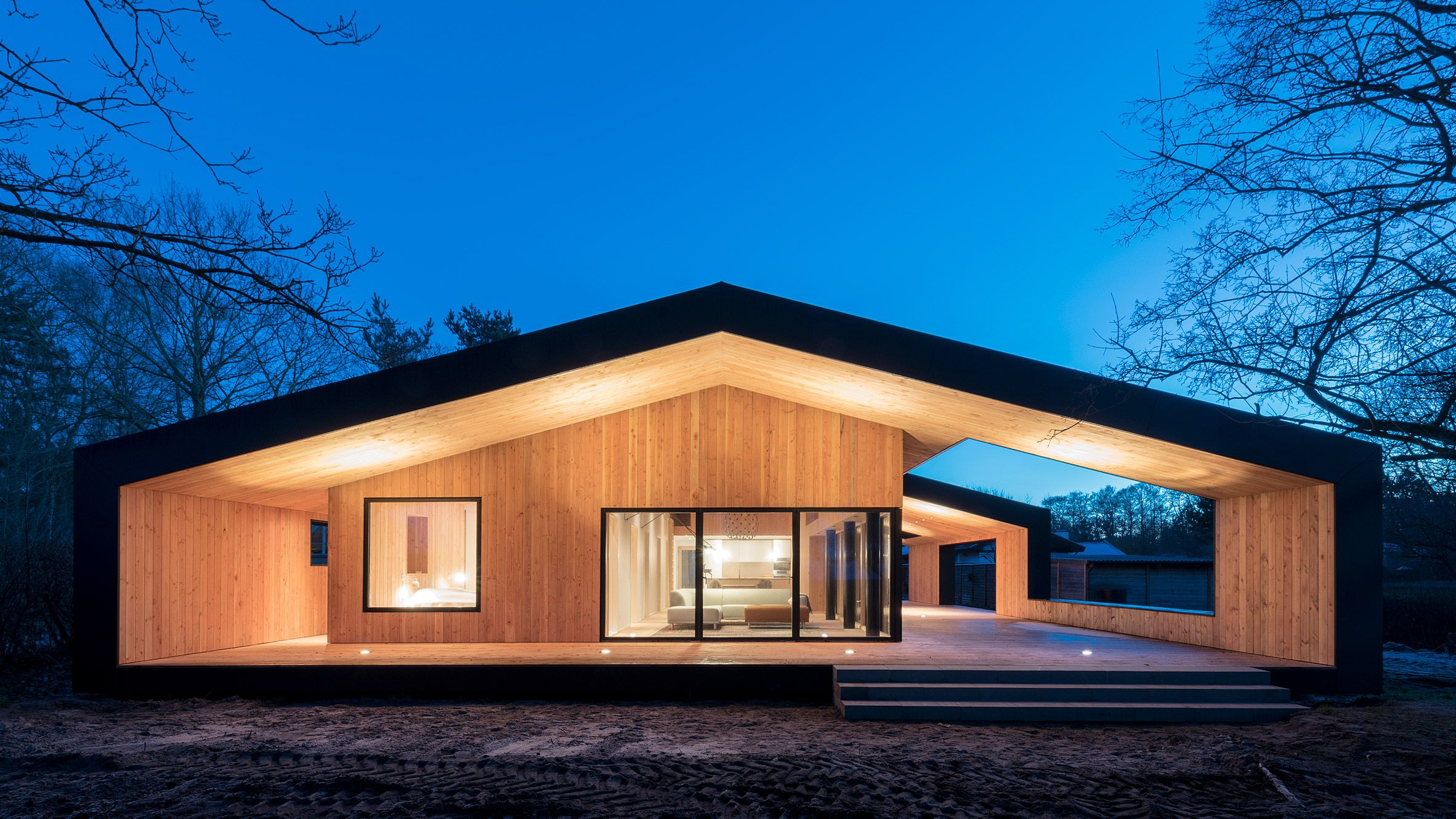 Best A Pitched Roof Extends Well Beyond The Internal Walls To Create Sheltered Terraces Around The 400 x 300