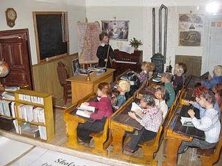 miniature school room (classroom) setting - traditional benches, teacher's desk, chalkboard, wood stove